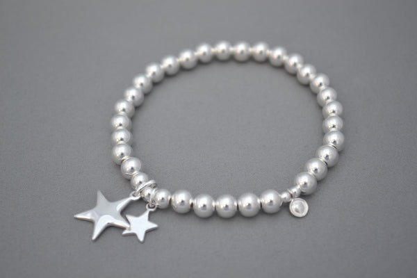 Sterling Silver large bead bracelet with twin Sterling Silver flat star charms