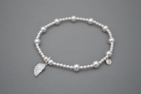 Sterling Silver mixed bead bracelet with Sterling Silver single angel wing charm.