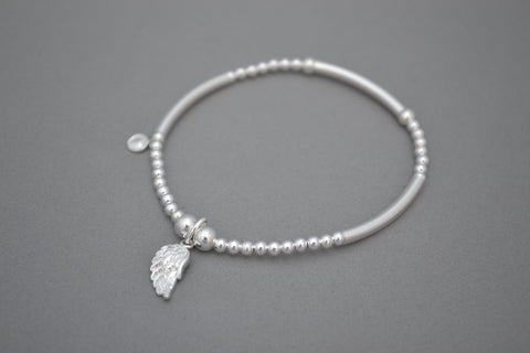 Sterling Silver noodle and 3mm bead bracelet with angel wing charm