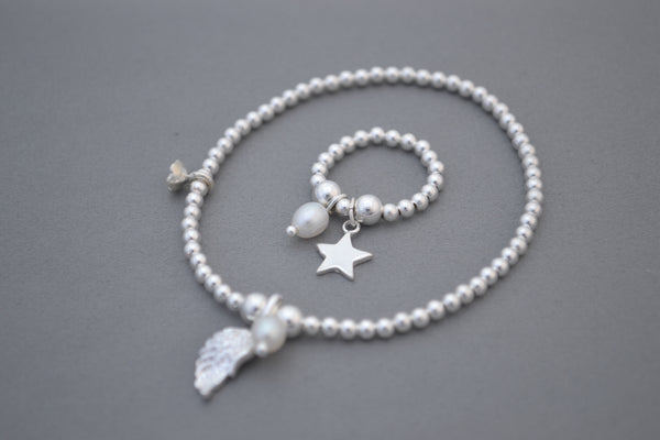 Sterling Silver 5mm and 3mm mixed bead bracelet with Angel wing and pearl charms