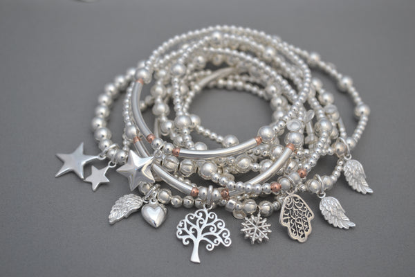 Sterling Silver mixed bead bracelet with Sterling Silver angel wing and puff heart charms.