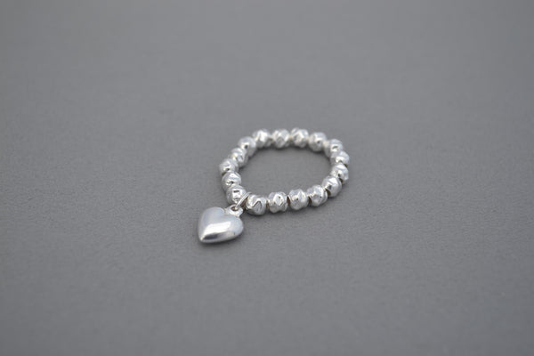 Sterling Silver hammered bead ring with Sterling Silver puff heart charm