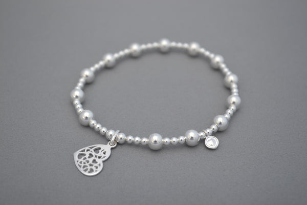 Sterling Silver small and medium bead bracelet with pretty multi heart charm