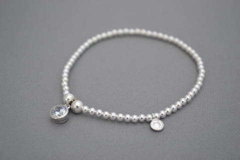Sterling Silver ball bead bracelet with clear crystal birthstone charm