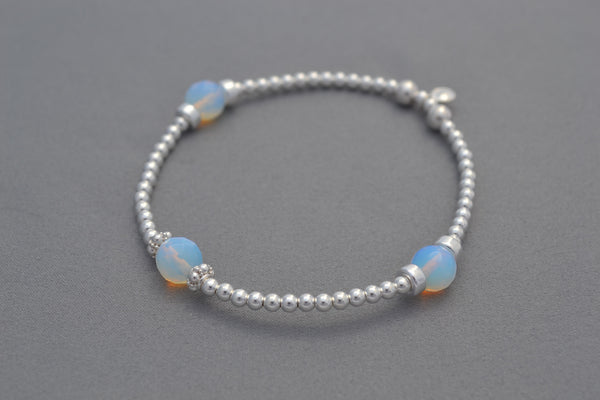 Moonstone and sterling silver round bead bracelet