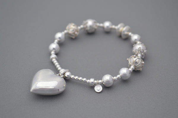 Sterling Silver bead bracelet with ornate Sterling Silver Bali beads and large heart charm