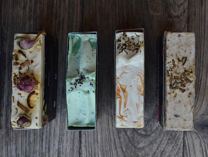 A top shot of four types of hand made soaps made by YellowBerry