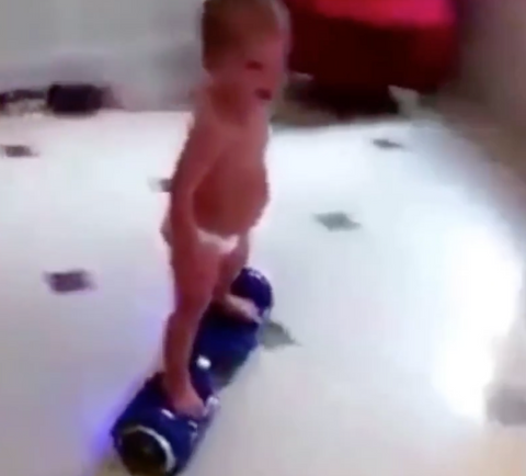 baby rides hoverboard
