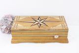 Wooden humidor with star marquetry pattern inlay