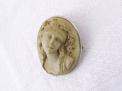 Antique Victorian lava cameo brooch of a young woman set in silver