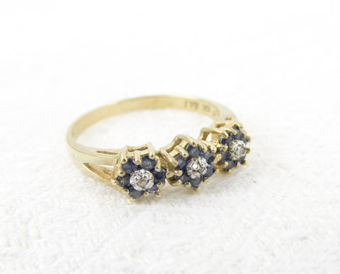 10K gold ring with 3 sapphire and diamond flowers size M / 6.25