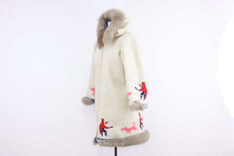 White handmade Inuit parka coat with hunters and pink wolves