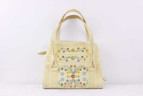 1950s tooled leather purse in soft yellow with colourful 4 leaf clovers