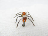 Silver and amber spider brooch