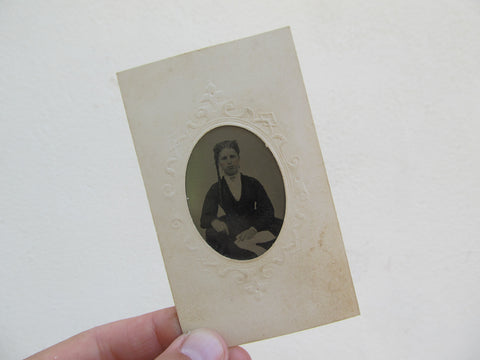 Victorian tintype of a young woman with braid