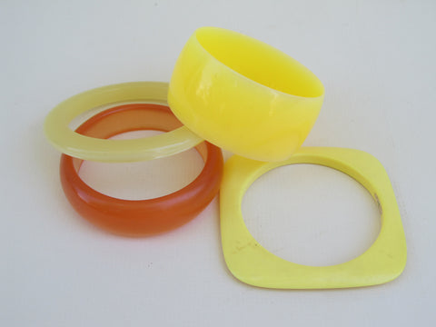 Colourful lucite bangle bracelet in applejuice, yellow and peach