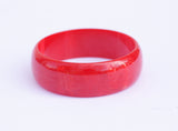 Red bakelite bangle bracelet, cherry red with swirl pattern