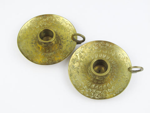 Pair Indian brass candle holders with flower engraving