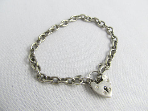 1950s Sterling silver charm bracelet with heart charm clasp