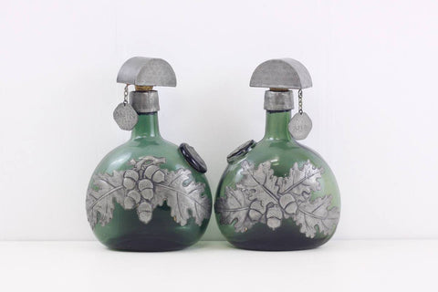 Arts and Crafts decanters, Marjorie Stokes pewter craft spirit bottles, vintage green glass decanters with acorn decoration