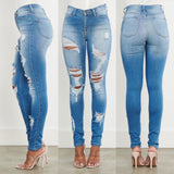 Mid Rise Destroyed Light Wash Denim