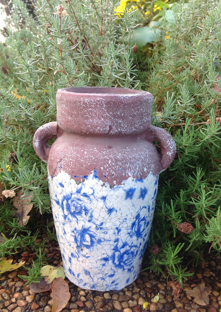 Vintage blue and white ceramic vase. Ancient Asian reproduction of a classic storage jug