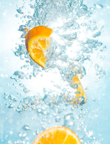Stay hydrated at the beach, oranges with water