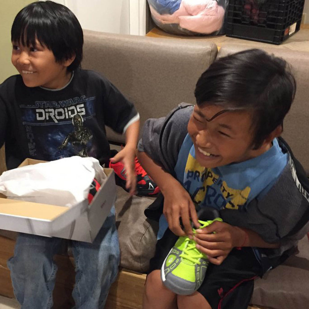 New shoes for 20 children in homeless shelters
