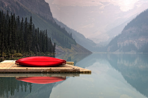 early morning with a red canoe