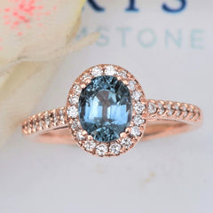 montana blue sapphire rose gold diamond halo ring