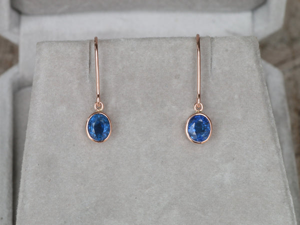 Blue Sapphire Dangle Earrings in 14k Rose Gold Oval Shape