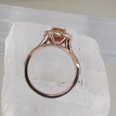 side view of heart shape peach sapphire rose gold ring