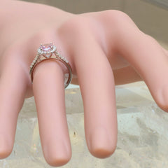 side view of pink sapphire diamond halo ring