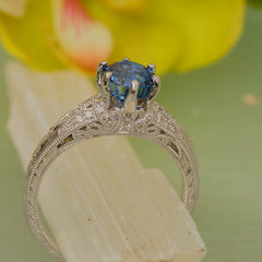 Vintage inspired blue sapphire engagement ring