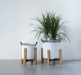 Distressed White Metal Planters with Black Rim & Handles on Natural Wood Stands (Set of 2 Sizes)