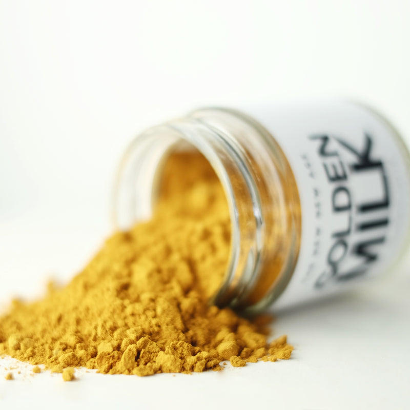 Close up of Golden Milk, an organic turmeric latte herbal powder blend made by The New New Age.