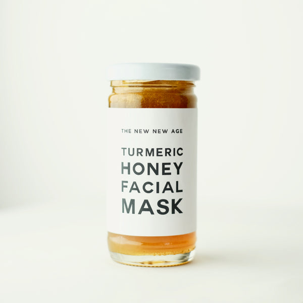 Jar of The New New Age Turmeric Honey Face Mask. Featuring raw honey and certified organic turmeric.