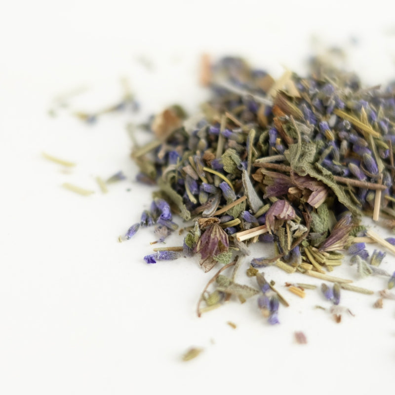 A close up of organic herbal tea, featuring sage, rosemary, lavender, lemongrass. This tea is called Mind Magic and is made by The New New Age.