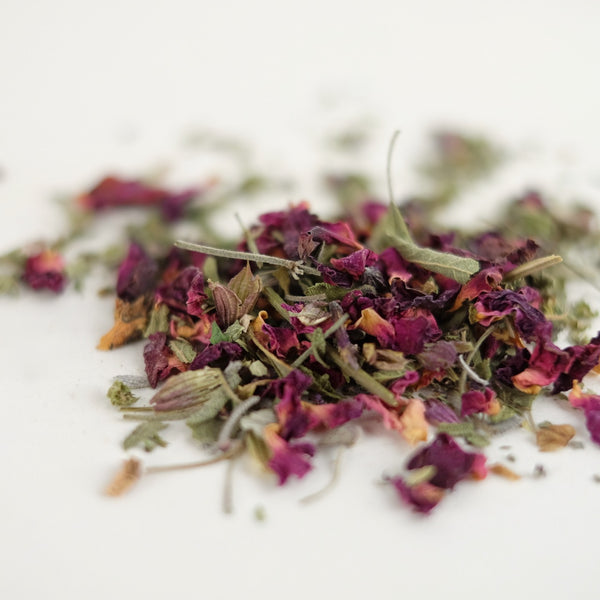A close up of organic herbal tea, called Sub Rosa, featuring rhodiola root, rose petals, holy basil, sage. Formulated by The New New Age herb farm.