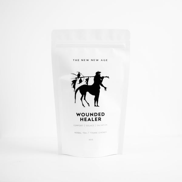 A bag of organic herbal tea called Wounded Healer. Formulated by The New New Age, this tea features yarrow, ginger, lemon verbena, lemongrass, lemon balm, blue cornflower, black pepper.