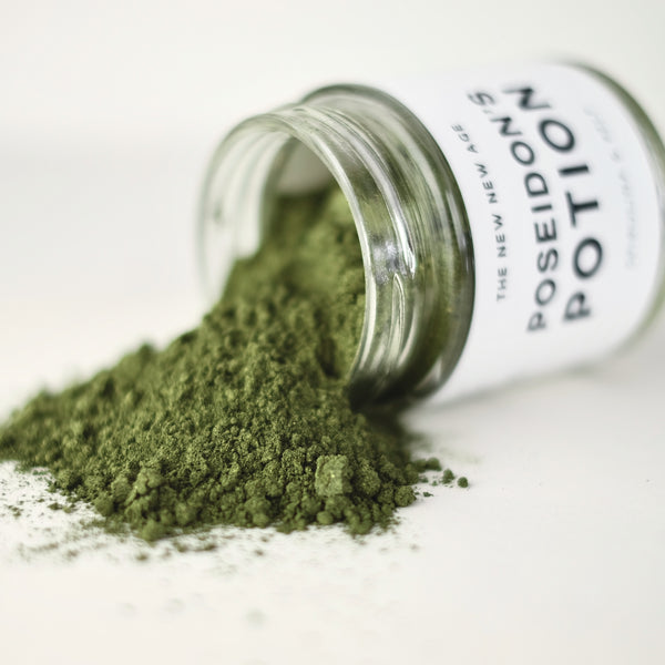 A close up of spirulina and kelp powder. This product is called Poseidon's Potion and is formulated by The New New Age.
