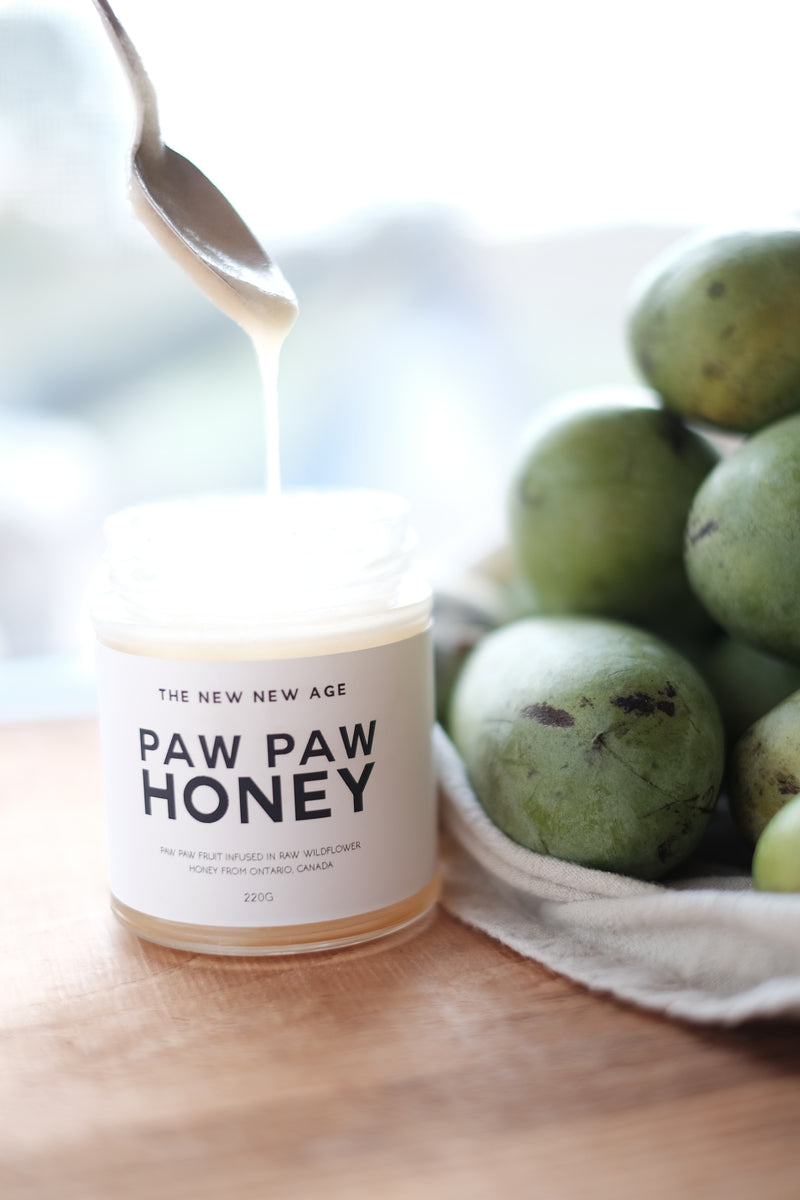 A jar of Paw Paw Honey, made with coconut oil infused with the Pawpaw fruit, grown by The New New Age farm. Also pictured are paw paw fruits.
