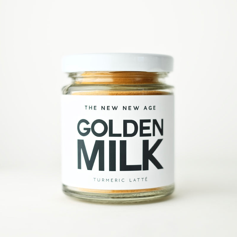 Jar of Golden Milk, an organic turmeric latte herbal powder blend made by The New New Age.