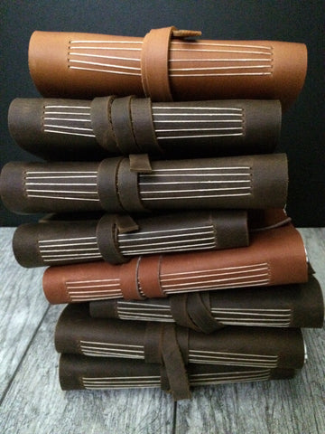 stack of handmade leather journals