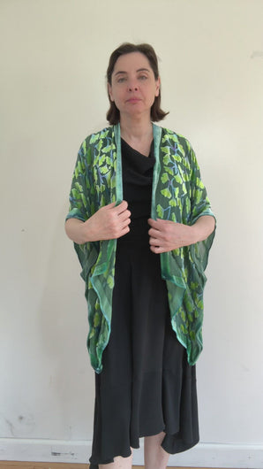 modeling  devoré or burnout velvet kimono jacket that is hand painted Gingko Leaves.