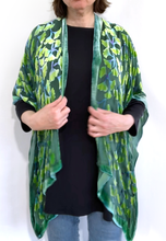 Load image into Gallery viewer, modeling the back of a  devoré or burnout velvet kimono jacket that is hand painted Gingko Leaves. Worn over back shirt and jeans.