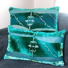 Load image into Gallery viewer, Two aqua blue rectangular hand painted burnout velvet Pillows with fleur de lis center on gray couch