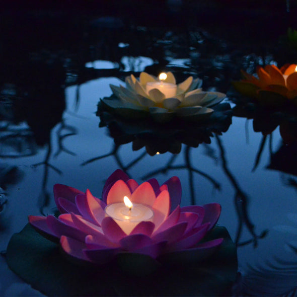 illuminated floating lotus flower with candle