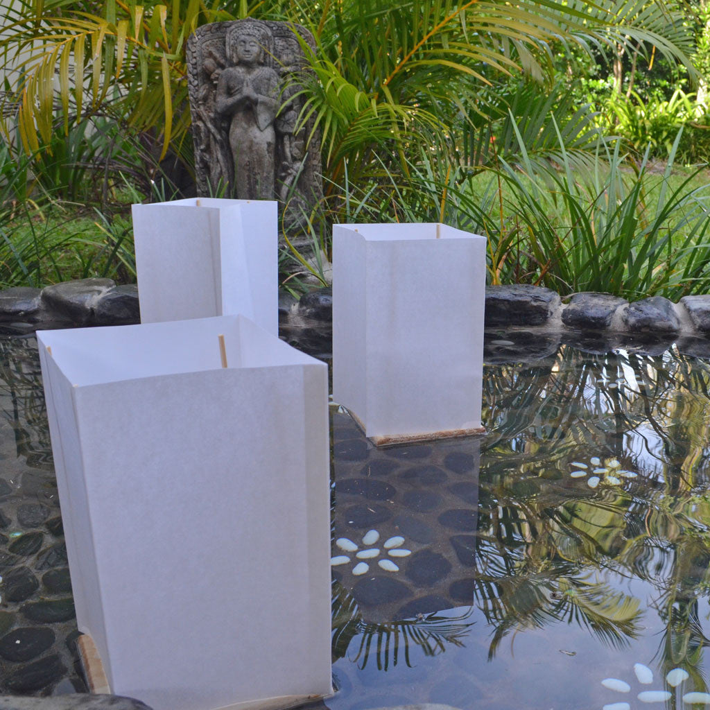 floating bamboo/white paper lanterns with candles
