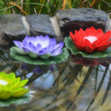 floating lotus flowers with candles